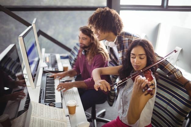 Three sound engineers working together Free Photo