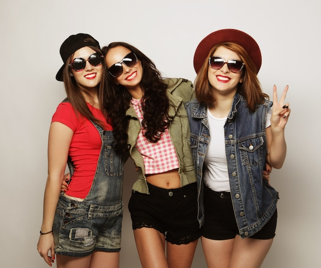 Three stylish sexy hipster girls best friends. Premium Photo