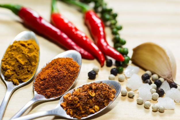 Three type of spices and herb on wood background,selective focus Premium Photo