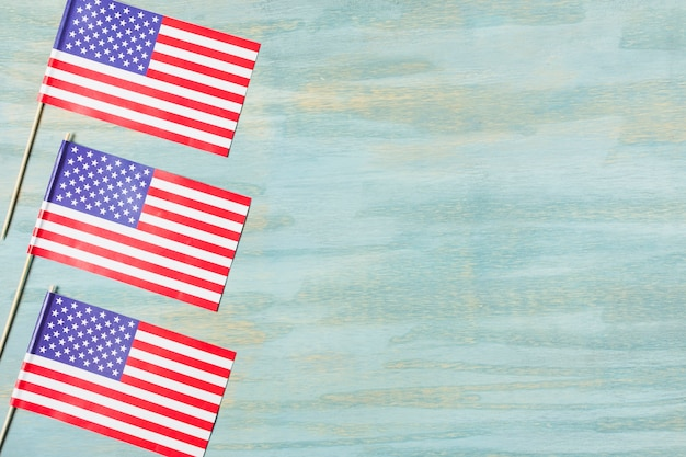 Three usa flags on colored textured background Free Photo