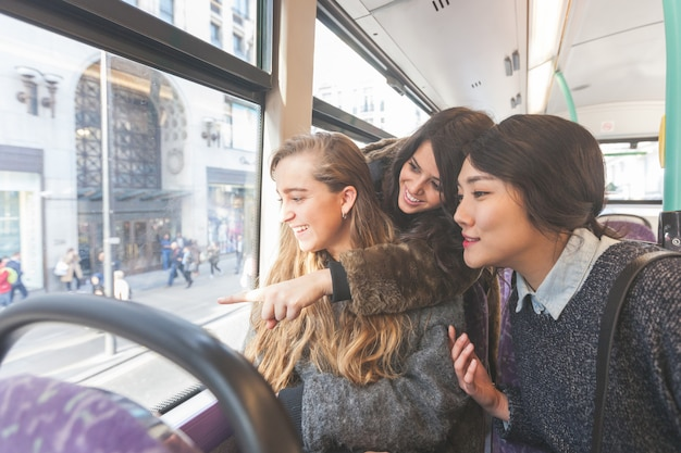 Three women looking out the window from. the bus Premium Photo