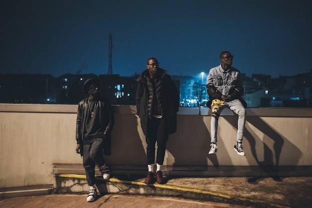 Three young african men posing together in a parking Premium Photo