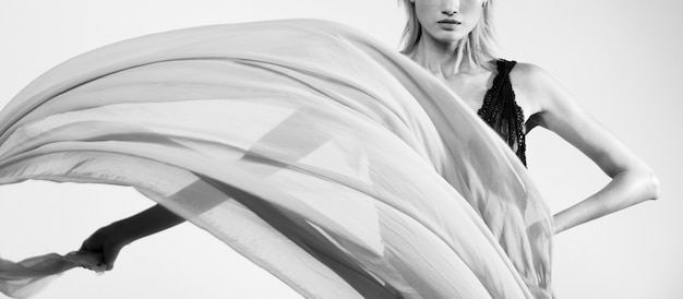 Throwing flow transparent fabric in the air woman Premium Photo