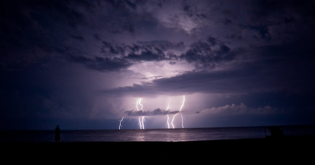 Thunder-storm and lightning in the sea. a lightning. Premium Photo