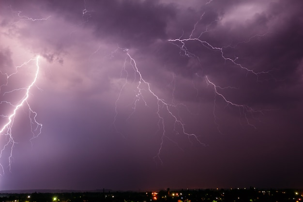Thunderstorm with lightning in the sky over a small town Premium Photo