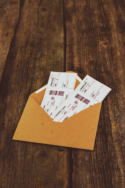 Tickets on wooden table Free Photo