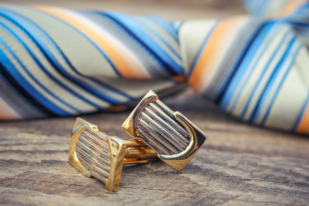 Tie, cufflinks and watches on the old wood background Premium Photo