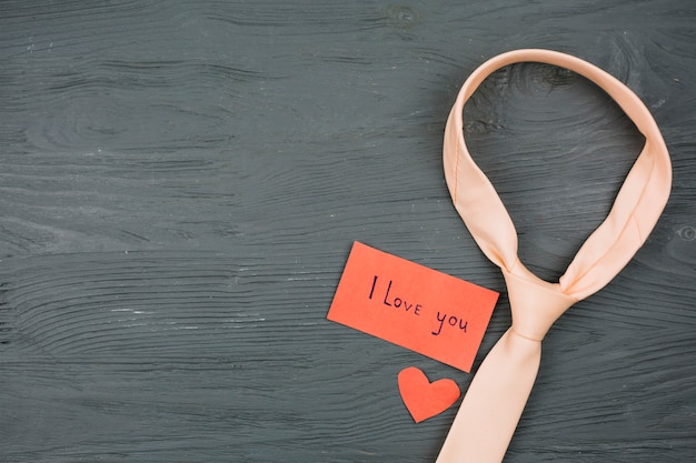 Tie near paper with i love you title Free Photo