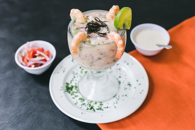 Tiger milk with shrimps and peruvian sauce Premium Photo