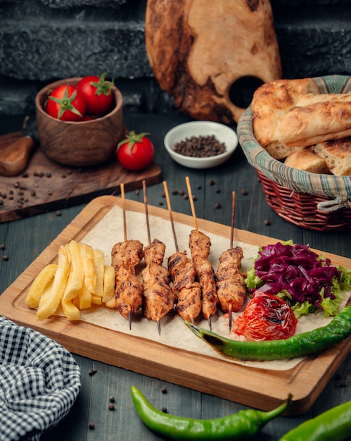 Tikka kebab with french fries and salad Free Photo