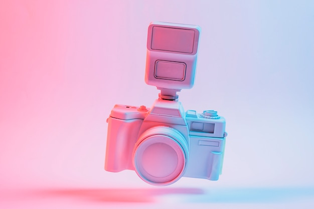 Tilt camera floating over the pink background Free Photo