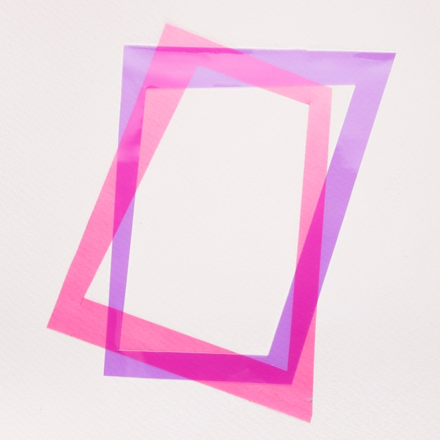 Tilt purple and pink frame on white background Free Photo