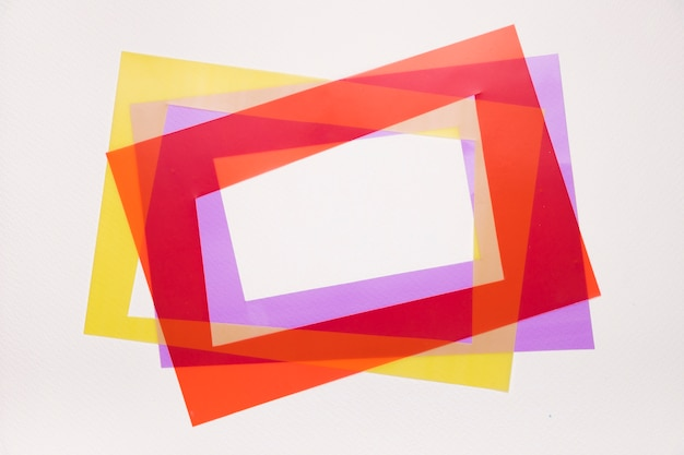 Tilt red; yellow and purple frame on white background Free Photo
