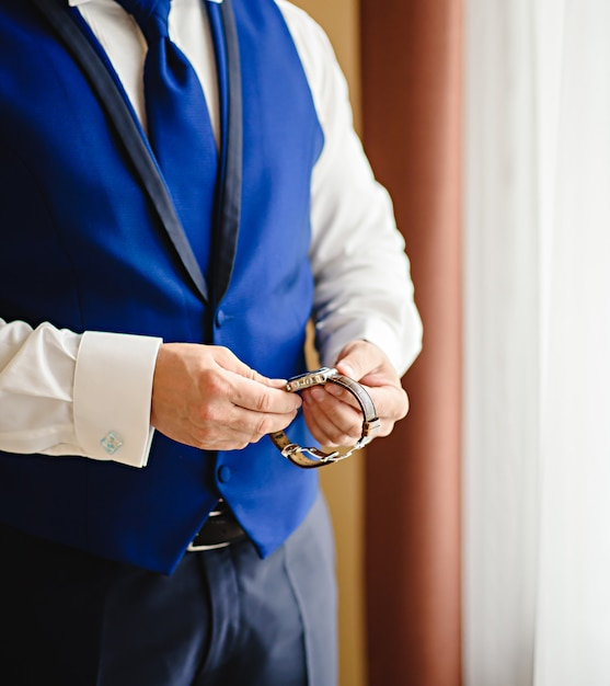 Time keeping for important appointment, a man looks on his watch of serious meeting. Premium Photo