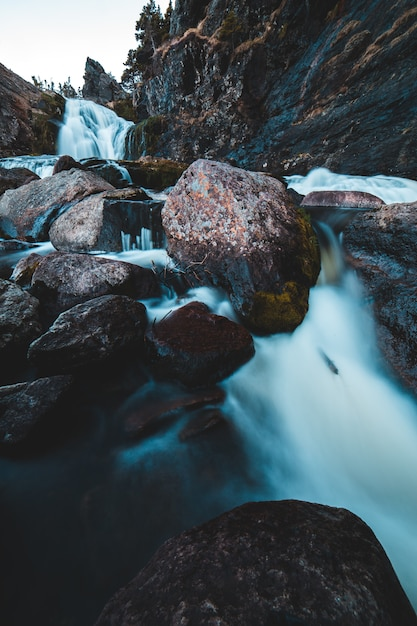 Time-lapse photography of flowing multi-tier waterfall Free Photo