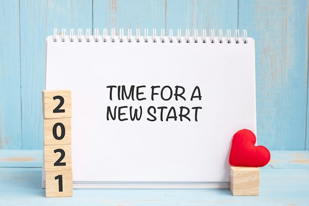 Time for a new start words and 2021 cubes with red heart Premium Photo