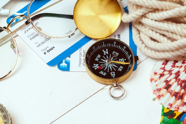 Time to travel. idea for tourism with tickets and compass. Premium Photo