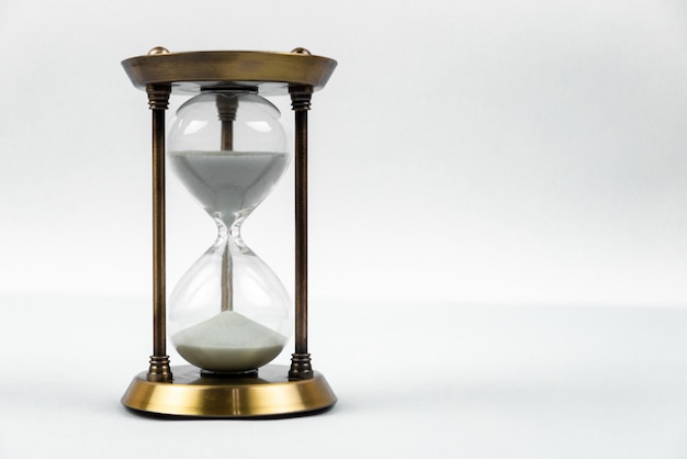 Time  with hourglass lying toned in warm Premium Photo