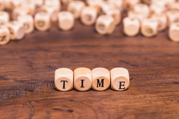 Time word made from wooden cubes Free Photo