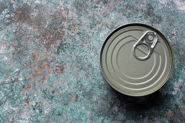 Tin cans for food on table Free Photo