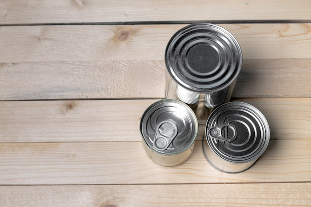 Tin cans for food on wooden Premium Photo
