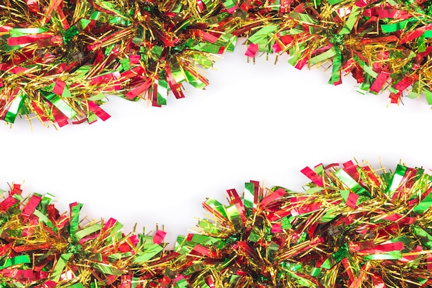 tinsel christmas decoration on a white background premium photo