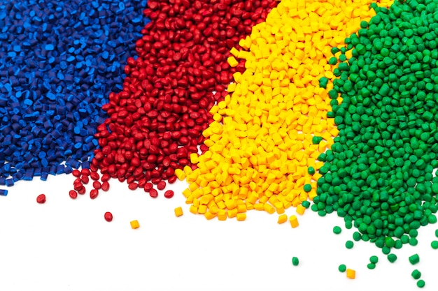 Tinted plastic granulate for injection moulding process Premium Photo
