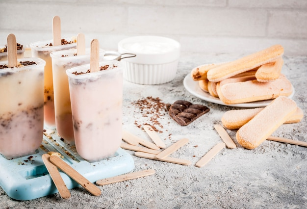 Tiramisu popsicles ice cream. gelato pops with italian savoiardi cookies Premium Photo