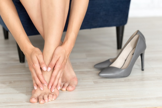 Tired and aching female feet after walking Premium Photo