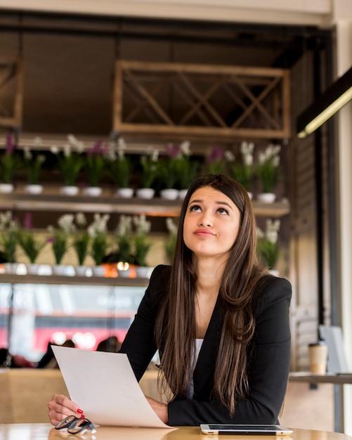 Tired brunette businesswoman Free Photo