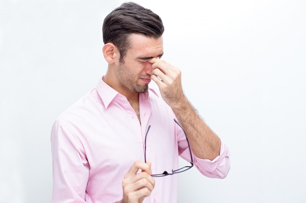 Tired Business Man Touching Nose Bridge Free Photo