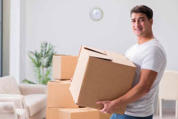 Tired delivery man with box Premium Photo