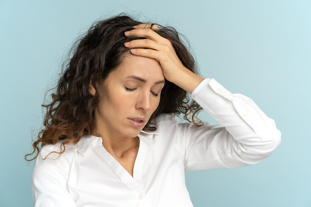 Tired frustrated business woman office worker sighing wiping sweat of forehead has emotional burnout Premium Photo