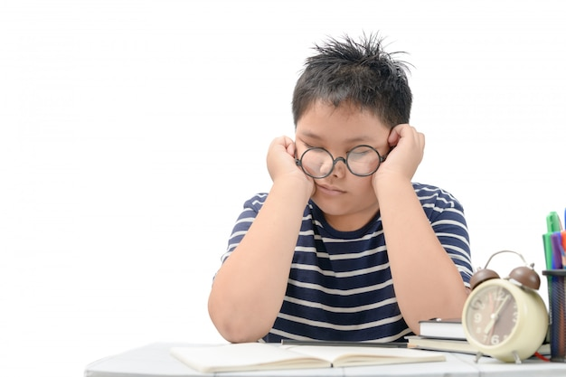 Tired student boy with glasses sleeping on the books Premium Photo