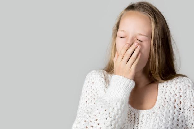 Tired teen yawning Free Photo