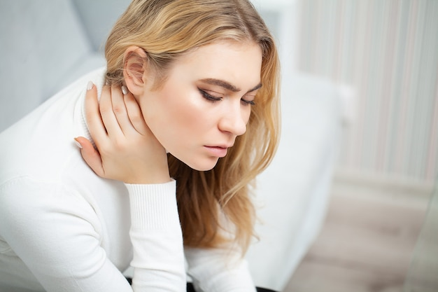 Tired woman keeping hand on her head Premium Photo