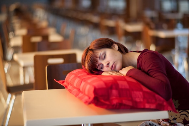 Tired Woman Sleeping On A Cushion Photo Free Download