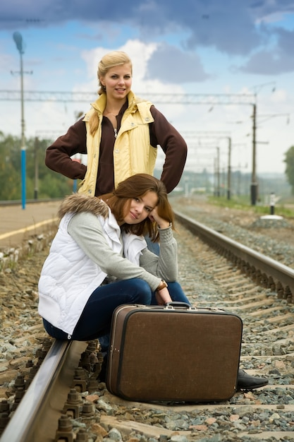 Tired women on rail station Free Photo