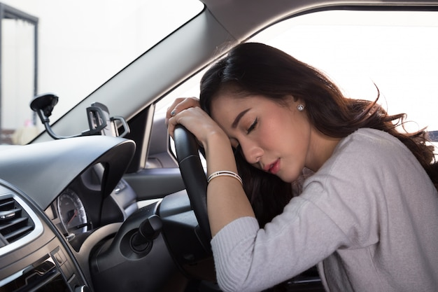 Tired young woman sleep in car Premium Photo