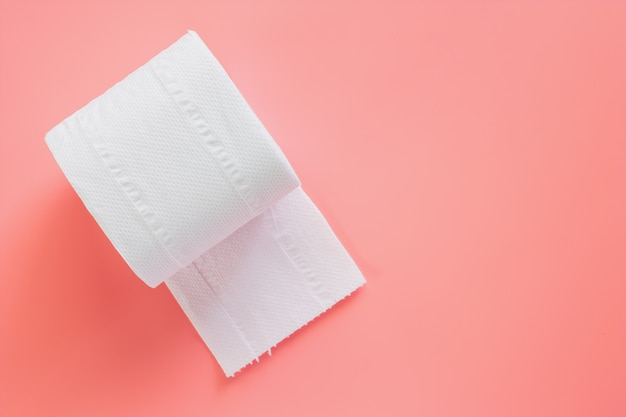 Tissue or toilet paper roll on pink background Premium Photo