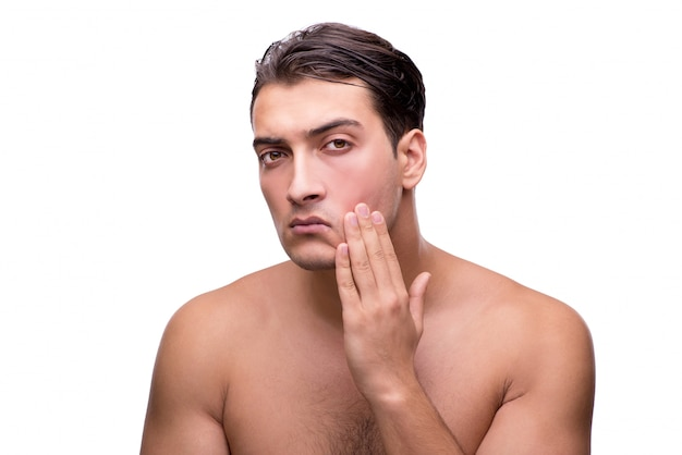 Tiyng man after shaving isolated on white Premium Photo