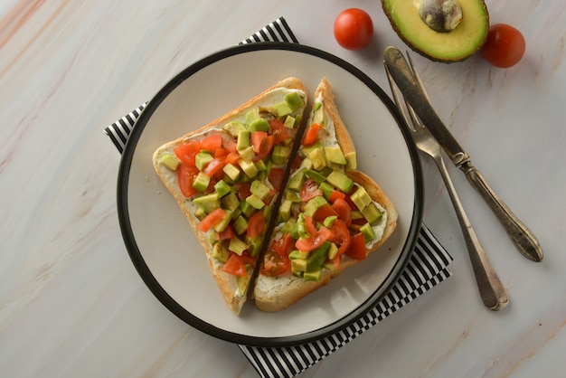 Toast with cream cheese, avocado and cherry tomatoes. healthy food. copy space. Premium Photo