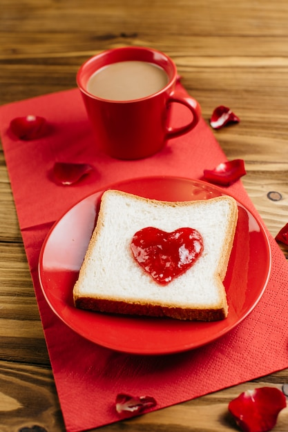 Toast with jam in heart shape on plate Free Photo