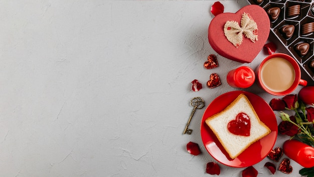 Toast with jam in heart shape with coffee cup Free Photo