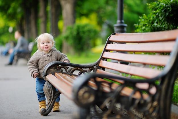 Toddler boy having a walk in the park Premium Photo