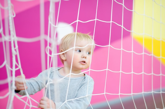 Toddler boy playing in indoors sport court Premium Photo