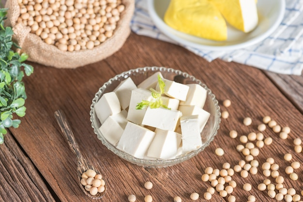 Tofu cut into cubes in bowl with soy bean. Premium Photo