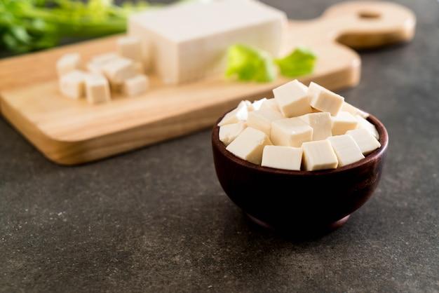 Tofu on wooden board Premium Photo