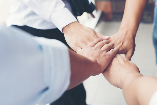 Together collaborate of hands teamwork in meeting room office Premium Photo