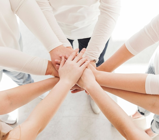 Togetherness group of women variety of hands Free Photo